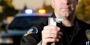 police officer with breathalyzer - Springfield charged with a DUI