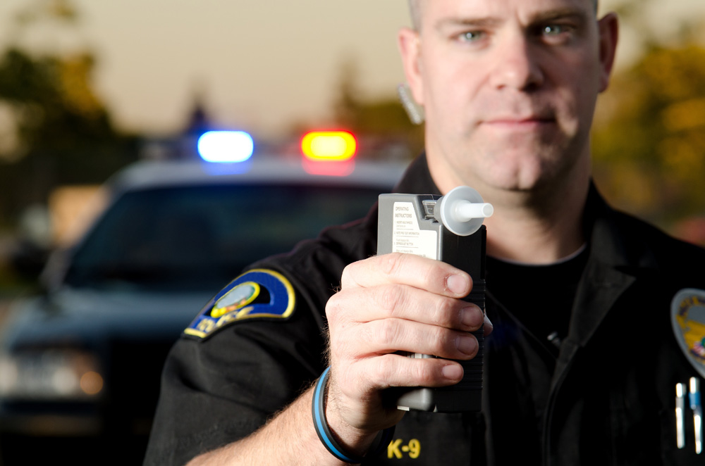 police officer with breathalyzer