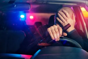 man drinking a beer at the wheel - Springfield DWI lawyers