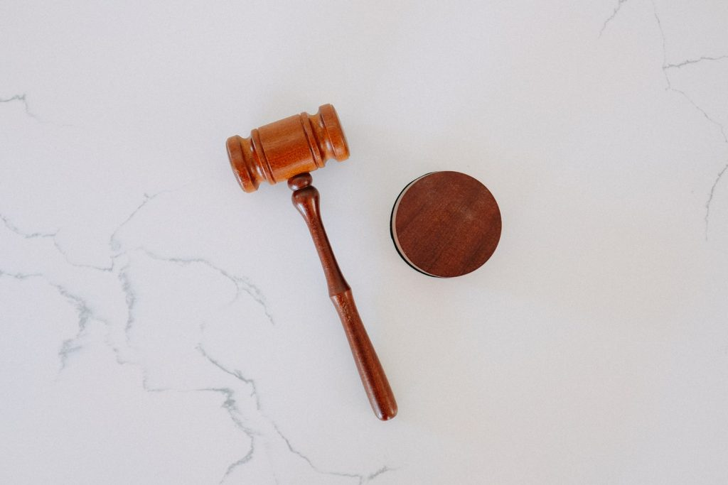 wooden gavel on white marble surface